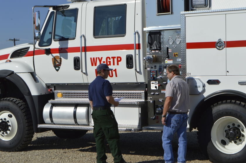 Bill Yohn inspects a fire safety vehicle at the National Interagency Fire Center